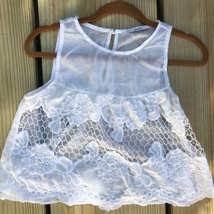 Babydoll white tank with floral cutout detail